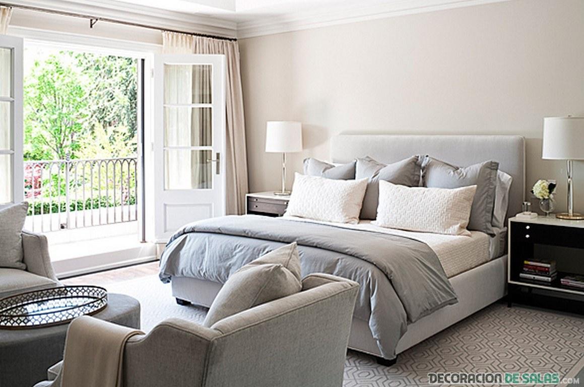 dormitorio de colores neutros con sala