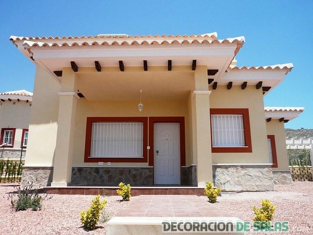 exterior de casa en beige y rojo