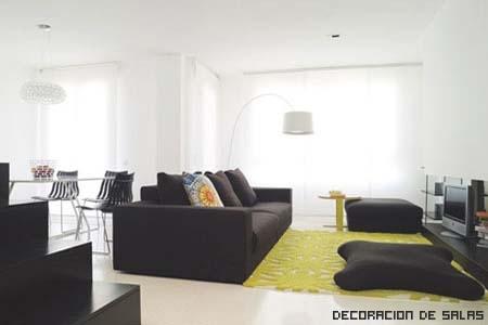 Consejos para decorar grandes estancias - Salones con sofa negro ...