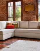 Los sofás esquineros o rinconera protagonizan estas decoraciones